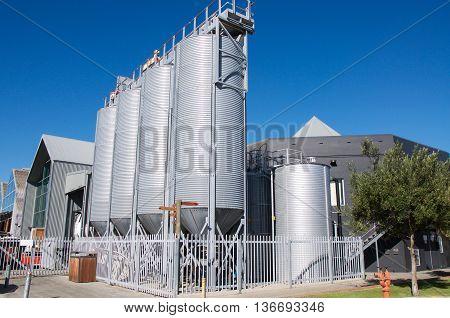 FREMANTLE,WA,AUSTRALIA-JUNE 1,2016: Little Creatures Brewery outdoor large conical fermentation vats in Fremantle, Western Australia.