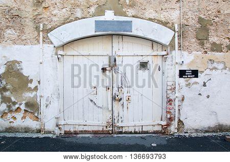 FREMANTLE,WA,AUSTRALIA-JUNE 13,2016: Weathered exterior wall doors at the Fremantle Prison in Fremantle, Western Australia.