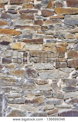 Ancient stone wall of quarry stones. Stone background.