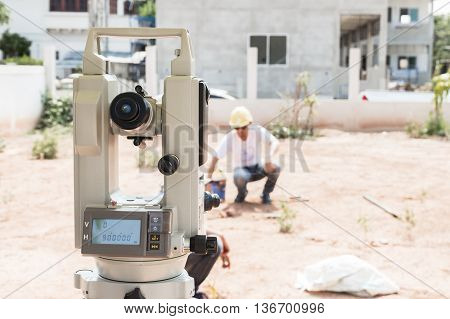Man survey checking before housing construction site