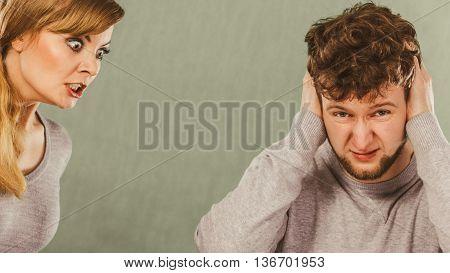 Aggressive Woman Yelling On Man.