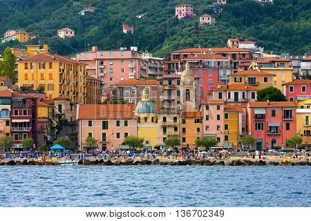 SAN TERENZO LERICI ITALY - JULY 28 2014: San Terenzo (St. Terenzo) beach crowded with bathers in a July evening. Lerici in the Gulf of La Spezia Liguria Italy