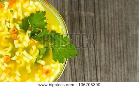 image of noodle soup on a wooden table