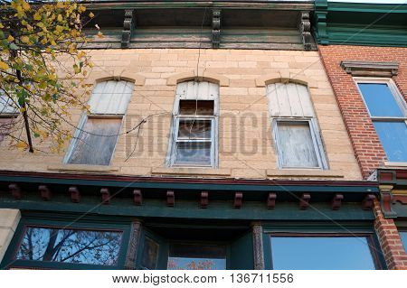The boarded up windows of a vacant building in downtown Joliet, Illinois.