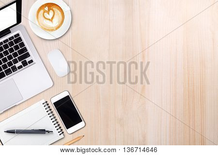 Top View Laptop Computer Or Notebook,mobile Phone And Cup Of Latte Art Coffee On Wooden Table.mobile
