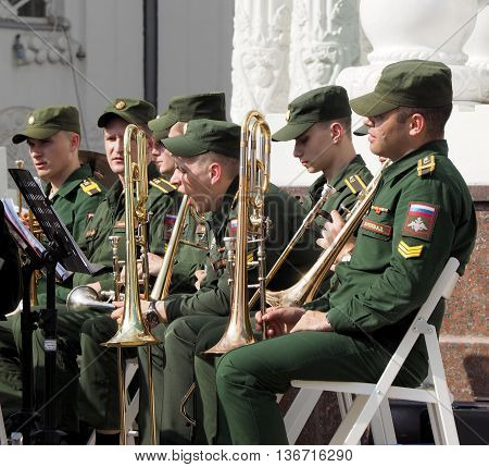 MOSCOW. RUSSIA - May 28, 2016: Trumpeters in anticipation for his musical part. Horn player before the performance. Brass band playing on the Central Avenue in the Park of VDNH. International Military Music Festival