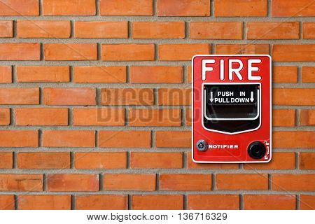 Fire Alarm Switch On Brick Wall Texture Background