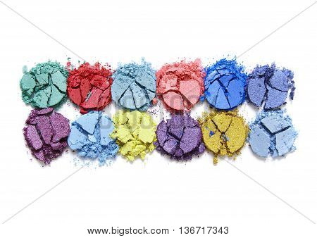 Broken colorful eye shadow make up palette isolated on a white background