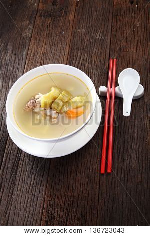 pork lib bitter gourd soup on the wooden background