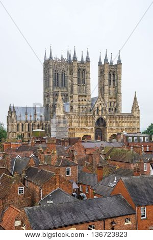 Lincoln Cathedral Lincoln England viewed across rooftops. It was built from 1088 over several phases