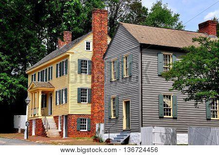 Old Salem North Carolina - April 21 2016:  Two 18th century colonial-era wood frame homes on Main Street