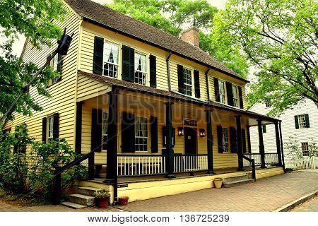 Old Salem North Carolina - April 21 2016: Old Salem Tavern still serves colonial restaurant food with wait staff dressed in 18th century Moravian clothing