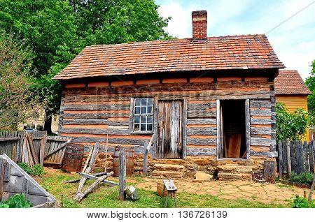 Old Salem North Carolina - April 21 2016: Fachwerk half-timber cabin behind the 1771 Miksch House *
