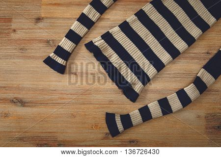 Knitted Sweater on the Wooden Background.Hand Made;Fancywork.knitting industry.