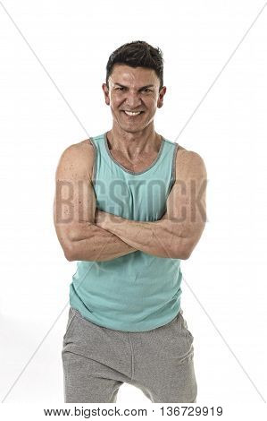 40s attractive hispanic sport man and bodybuilder smiling happy in corporate cross arms pose wearing singlet having very fit and muscular body in mature bodybuilding and body care isolated