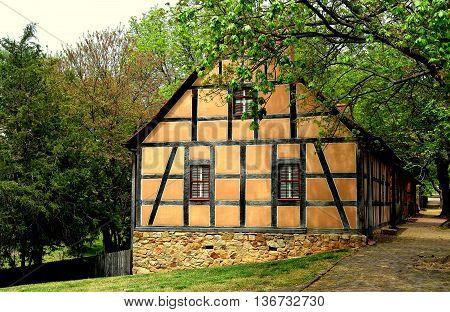Old Salem North Carolina - April 21 2016: Fachwerk stucco and half-timber 18th century Moravian houses on Main Street