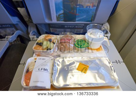 NEW YORK - APRIL 06, 2016: meal in Economy Class of a  Lufthansa Boeing 747.  Lufthansa is a German airline and, when combined with its subsidiaries, the largest airline in Europe.