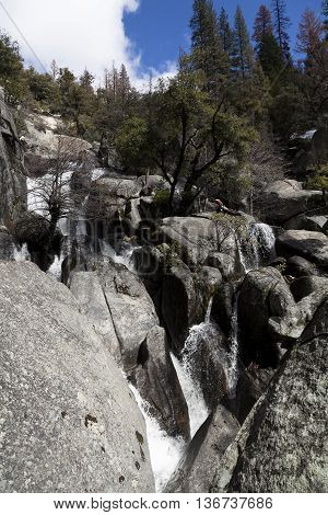 Granite Rocks Green Trees Blue Sky With White Clouds And Cascading Waterfalls Yosemite National Park