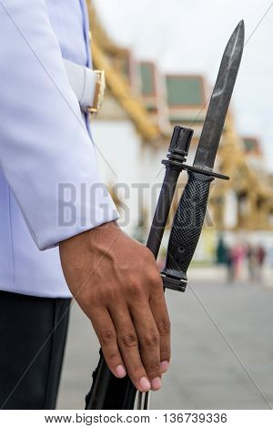 A member of the King's Guards on duty with a rifle and bayonet Bangkok Thailand.