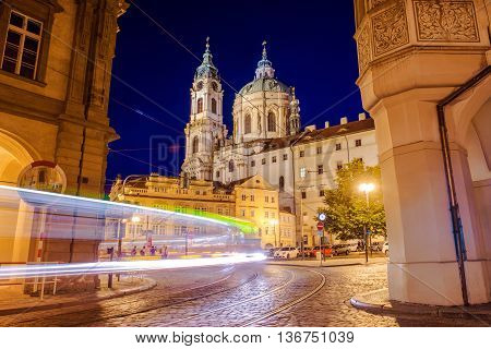 Prague St. Nicholas Church Mala Strana at Night with Night Traffic in Motion.