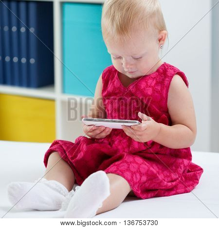 Little Cute Girl Using Phone