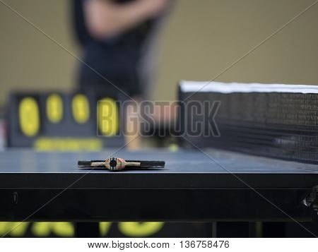 Table Tennis racket on a Table Tennis Table - Focus at the Racket/Blade and shallow DOF