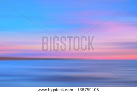 Abstract motion blurred pink mauve and blue background. Seascape at sunset.