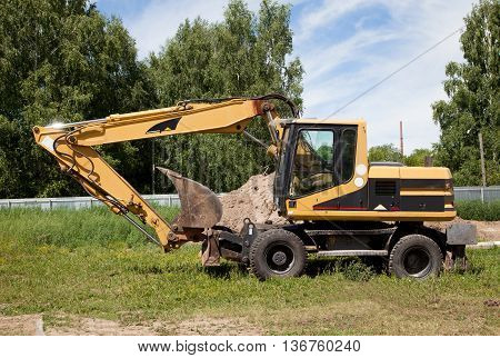 Excavator; Power Shovel; Steam Shovel; Earth-moving Mashine; Dredge Standing On The Ground