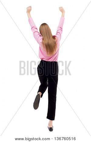 Back view of  business woman.  Raised his fist up in victory sign. Raised his fist up in victory sign. Isolated over white background. girl office worker in black trousers held up her hands and legs