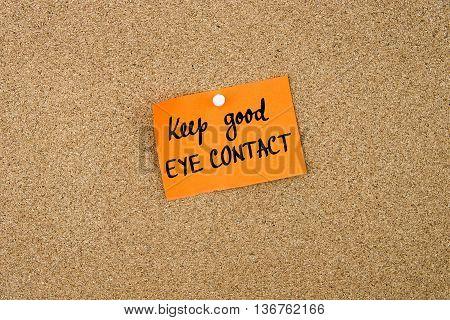 Keep Good Eye Contact Written On Orange Paper Note
