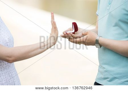 Close-up Of A Woman Refusing Her Boyfriend To Marry After Being Proposed