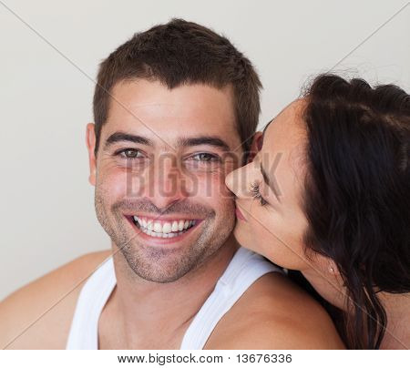 Young woman kissing her Boyfriend