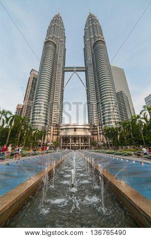 Kuala-Lumpur Malaysia - June 23 2016: View to Petronas Tower and foutain