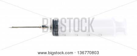 Two oz syringe isolated over the white background
