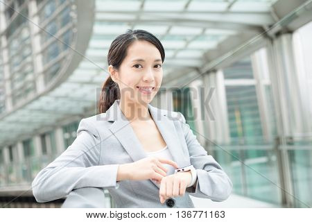 Asian buiness woman using smart watch for work