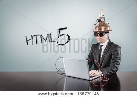 HTML5 concept with vintage businessman and laptop at office