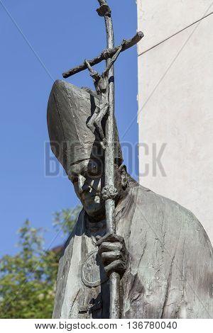 Bronze statue of St. John Paul II on Altar Three Millennia Church on Skalka Pauline Fathers Monastery Krakow Poland poster