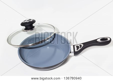 Frying pan with glass cover, isolated on a white background.