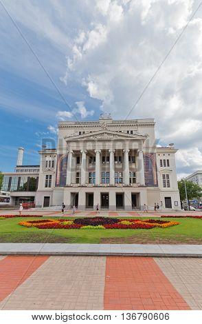 RIGA LATVIA - JUNE 29 2016: Latvian National Opera (circa 1863) on the Aspazijas (former Theater) Boulevard in the historic center of Riga Latvia. Architect Ludwig Bohnstedt