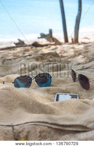 Flip Flops, Sunglasses, Towel On The Beach