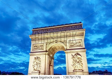 The famous Arc de Triomphe in Paris at dawn