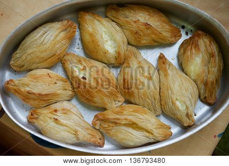 Maltese baking delicacy, pastizzi.Pastizzi, typical street food Maltese with ricotta and peas. Maltese food. Photo from the top poster