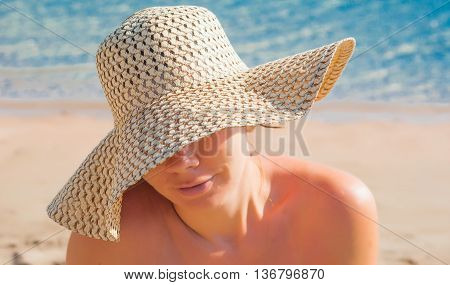 Young Woman In A Straw Broad-brimmed Hat, Part Of The Face Covered