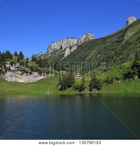 Summer day at lake Fahlensee Appenzell Canton. Bollenwees and mountains of the Alpstein Range.