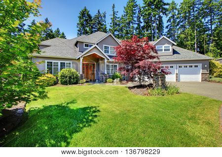Beautiful Curb Appeal. Large Beige House With White Trim.
