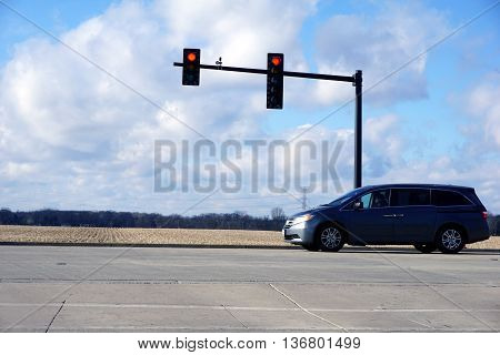 PLAINFIELD, ILLINOIS / UNITED STATES - DECEMBER 1, 2015: A motorist waits to turn left into the parking lot of the Saint Mary Immaculate Parish Church in Plainfield.