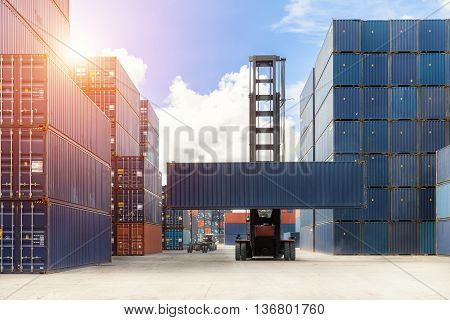 Import Export Logistics concept - Crane lift up container box loading to container depot use for cargo import export logistics background.