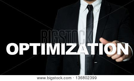 Business man pointing the text: Optimization