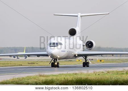 MOSCOW, RUSSIA - SEPTEMBER 26, 2014: Yakovlev Yak-42 Tulpar airlines taxiing. for take off at Domodedovo international airport