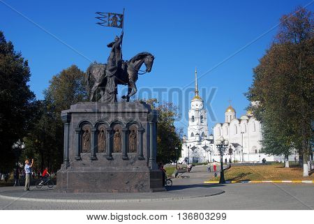 VLADIMIR, RUSSIA - SEPTEMBER 26, 2015: Monument of Prince Vladimir against Assumption cathedral (Dormition Cathedral) in Vladimir, Russia. Golden Ring of Russia. UNESCO World Heritage Site.